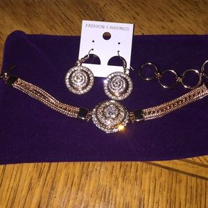 Brand New Beautiful Gold Earrings and Bracelet set